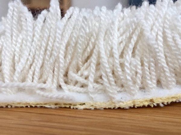 刺繍式のラグの断面写真